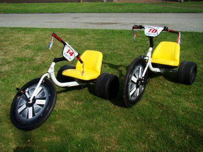 Pair of white custom High Roller trikes